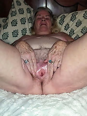 Mature mom is spreading legs